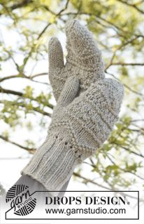 """Knitted DROPS mittens, hat and scarf with textured pattern in """"Nepal"""", pompoms in """"Vienna"""". ~ DROPS Design"""