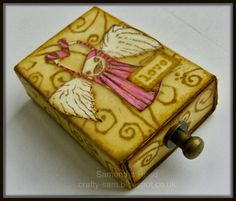 One of the pleasures I get from playing with inks and stamps is finding something really quite boring such as an empty match box and turn...