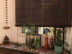 This pic is part of Anuradha Singh's Home Tour at Noida on The Keybunch decor blog - The corner of the room is decorated by hanging Diya, Anokhi, Dili haat, Nappadori, green plants etc Old Antiques, Antique Shops, Madhubani Painting, Blue Pottery, Safe Haven, Indian Home Decor, My Furniture, Victoria And Albert Museum, Green Plants