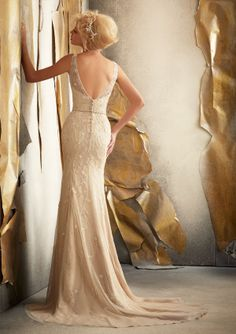 A beaded belt is a removable option; however the beauty of this gown is no option at all. Your makeup is done and every hair is in place...slip into this gown and into a world of loveliness! Live happily ever after! Removable Beaded Belt. Colors Available: White, Ivory, Champagne #timelesstreasure
