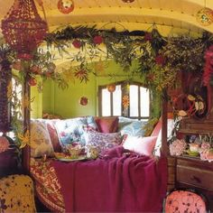 bohemian. Greenery around bed. Love the colors.