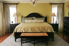 The light color scheme and symmetry are a wise way to go in a smaller master bedroom.    Houzz.com