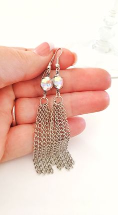 Trending silver tassel earrings with vintage Swarovski crystals.  Beautiful special occasion jewelry.  https://www.etsy.com/listing/556388564/earrings-silver-tassels-with-vintage