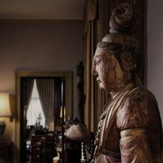 One of the earliest purchases of Robert Hatfield Ellsworth, a carved figure of Guanyin shown in the Living room. See: http://www.christies.com/auctions/asian-art-week-new-york-march-2015/ellsworth#collection-section