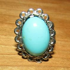 Turquoise Colored Ring $$OBO$$ Band is adjustable. Some glue on the surface.  CLOSET CLEAR OUT! Taking all offers as long as they are made using the button! Also bundling for a bargain with 20% off 2 or more! Jewelry Rings