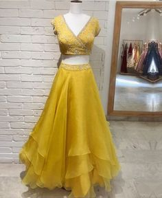 A synergy of colours from the Discover our layered Organza Skirt paired with a chic wrap around blouse 💛 . Party Wear Indian Dresses, Indian Gowns Dresses, Indian Bridal Outfits, Indian Fashion Dresses, Dress Indian Style, Indian Designer Outfits, Designer Dresses, Red Lehenga, Lehenga Choli
