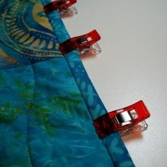 How to use binding clips as a guide for machine sewing binding onto a quilt.
