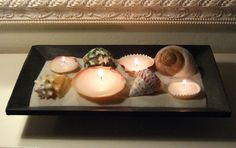"DIY Sea Shell Candles     Ooh!  Maybe can use recipe for sand ""play doh"" that hardens.  Stick shells in there."