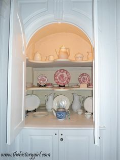 China cabinet located the front parlor of the historic Burrowes Mansion, located in Matawan, NJ. Built in 1723, this Georgian style mansion was built by John Bowne, III. In 1769, it was purchased by John Burrowes, Sr. The home played a part in a Revolutionary War skirmish in May of 1776. Discover more history at www.thehistorygirl.com