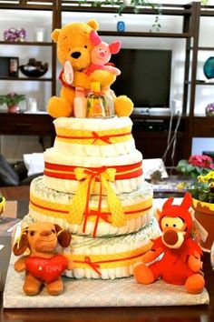 Winnie the pooh themed baby shower diaper cake