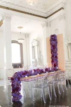 Wedding Table with Cascading Purple Flowers and Candles / Jessica Claire / Bloom Box / via StyleUnveiled.com