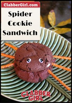 SPIDER COOKIE SANDWICH - Buttercream frosting is sandwiched between 2 chocolate cake-like cookies for these scary spiders! Push the pretzels into the sandwich for the perfect mix of salty sweet treats on Halloween.