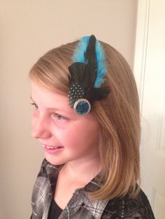 A personal favorite from my Etsy shop https://www.etsy.com/ca/listing/278506564/teal-feather-fascinator