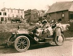 Women suffragettes in an early model car, poster available for purchase through the Museum Store.