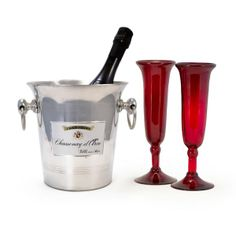 Loving Toast Gift Set  $100.00  Pop the cork on a special night. This stunningly simple gift set includes our Vintage Champagne Ice Bucket and a pair of Crimson Recycled Glass Flutes. Just add a bottle of your favorite bubbly, and you're set to offer the most romantic, and sustainable, toast around.