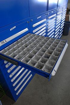 Plastic bins can be added to cabinet drawers, keeping small parts organized and separated. http://www.stanleyvidmar.com/see-it-work/image-galleries/automotive-parts