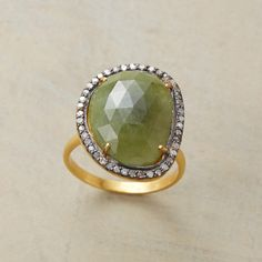 GALAPAGOS RING--Gleaming diamonds trace the irregular outline of opaque green sapphire, the stone prong set in rhodium plated 22kt vermeil on a 14kt gold band. Handcrafted in whole sizes 5 to 9.
