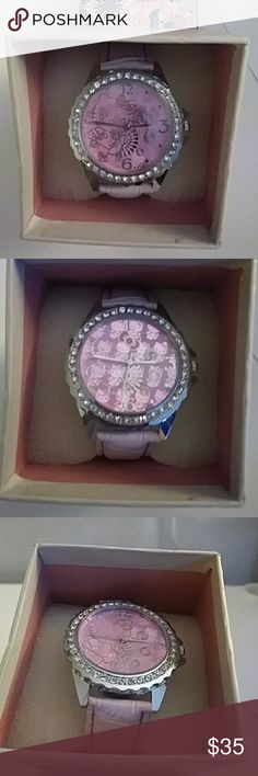 NEW IN THE BOX HELLO KITTY REINSTONE WATCH LEATHER Gorgeous brand new in the box Hello Kitty rhinestone watch lavender band purple face stainless steel backing absolutely gorgeous Hello Kitty Accessories Watches