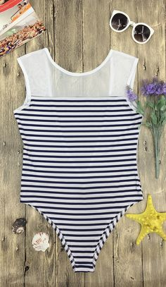 This one piece swimsuit featurs color block striped print and scoop back design. Keep your style looking hot and fresh this season with this.  Find more surprise at azbro.com!