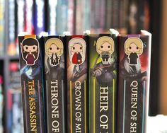 """New @happyhelloart bookmarks! Adding to my never ending collection of them. These are part of the Throne of Glass series, I recognize Manon and I think…"""