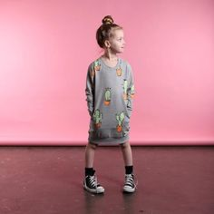 Minti Cactus Pocket Crew Dress in Grey Marle Minti are a boutique kids clothing brand based in Melbourne, Australia. They always design things that we think we'd like to wear (if we were small of course). We have a fantastic range of Minti available right here at Little Styles.