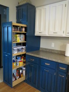 Gorgeous Kitchen Cabinet In White And Blue Paint Color Featuring Pull Out Pantry Cabinet Design And Grey Granite Counter Top And Laminated Wooden Floor Ideas. White and blue kitchen pantry cabinet combined with grey granite counter top. Using pull out system for food storage and kitchen powder ideas.