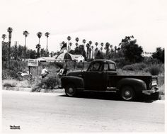 """Unidentified parcel of property for sale in Reseda, circa late 1950s. Three men are visible sitting near a sign that reads: """"Lots for sale to colored only, H. G. Weaver, DI. 8-1835."""" San Fernando Valley History Digital Library."""