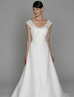 I love the lace, and the slightly off-shouldered cap sleeve. By Monique Lhuillier.