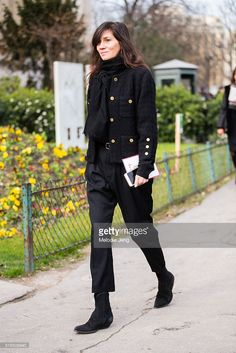Emmanuelle Alt, Vogue Paris Editor in Chief wears an all black outfit (scarf, jacket, trousers, boots) at the Chanel show at Grand Palais on March 07, 2016 in Paris, France.