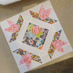 Field Day quilt block - b by twinfibers, via Flickr. How to use feature fabrics squates on the diagonal
