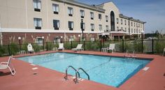 Holiday Inn Express Hotel & Suites Pell City Pell City This Alabama hotel features an outdoor pool with a sun deck, fitness center and spacious rooms with free Wi-Fi. Talladega Superspeedway is a 20-minute drive from Holiday Inn Express Hotel & Suites Pell City.
