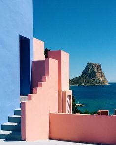 La Muralla Roja ('The Red Wall') is a mystical social housing project on Alicante's Arcadian coastline, conceived by the idealist architect Ricardo Bofill in the late '60s. Bofill isn't just an architect – he's a visionary who uses his creativity and talent to transcend his art to a higher state of consciousness. His work gives you a sense of heaven on Earth: limitless infinity and connected oneness, allowing its inhabitants to escape their ego and inviting them to realise their true…