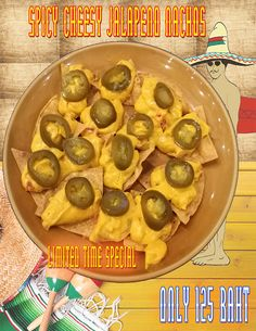 Spicy Cheesy Jalapeno Nachos with Queso cheese and sliced jalapenos on nacho corn chips for only 125 Baht #tequilareef #quesocheese #mexican #appetizer #restaurant #pattaya #thailand
