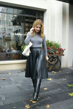Gray sweater and black pleated midi skirt with boots