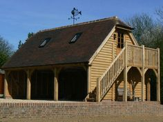 Professional and experienced builders of Oak Framed Garages in Oxfordshire, Hampshire, Berkshire and Buckinghamshire. Oak Framed Buildings, Garage Loft, Garages, Hampshire, Lounge, Cabin, Architecture, House Styles, Home Decor