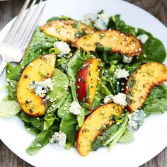 A lively summer salad full of spicy arugula, bold blue cheese and sweet juicy peaches.