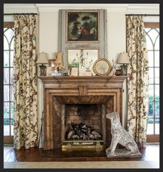 Charming living room mantel guarded by stone dog - A Little English Interiors