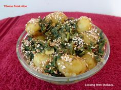 Tilwale Palak Aloo, side dish with a delicious sprinkling of roasted sesame seeds on baby potatoes and spinach.