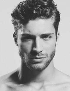 Thick & short curly hairstyle for men with stubble beard