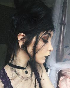 stunning dark hair with a dark smoky eye and black lips