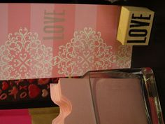Embossing with white powder looks beautiful against the pink stripe cards.