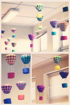 Luchtballonnen van gevlochten papier. Papier formaat 49x49 cm. Gemaakt door leerlingen van groep 8. Patroon is te vinden via: http://hobby.blogo.nl/2013/01/13/luchtballonnen-knutselen-met-vilt-of-papier-en-gratis-patroon/