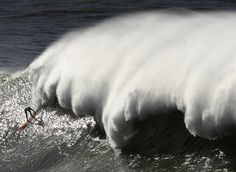 A surfer takes part in the Arnette Punta Galea Big Wave World Tour, on January 28, 2013 in the Northern Spanish Basque town of Getxo. (Rafa Rivas, AFP / Getty Images))