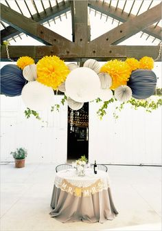 Yellow, charcoal, and white poms