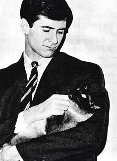 Anthony Perkins with Siamese cat