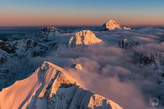 Julian Alps - The highest peaks of Julian Alps bathing in an evening sun.  Flying with an ultralight aircraft with just a small opening for the camera lens, with constant vibrations and turbulence it is very difficult to frame correctly and to get sharp photos. This time it was even more difficult as the sun was already low and weakening and the fact I got frostbites on my fingers did not help either.   Because of all this I am even happier to get this shot, where composition works well…