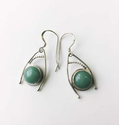 "These sweet little earrings have a quirky, Art-Noveau sort of style. They are triangular, with a 1/2"" minty green aventurine stone and an arcing accent of beaded wire. Perfect for everyday or dressing up. The earrings hang about 1 inch from French hooks. 