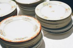start buying mismatched plates from thrift stores now, super cheap (cheaper than renting) and would add a fun touch...