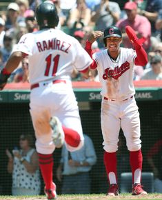 56d857f0ddf Cleveland Indians Francisco Lindor watches as Jose Ramirez touches home  plate