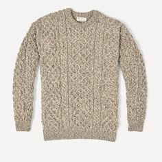 The result of our collaboration with world-renowned Irish clothing retailer, Carraig Donn. This traditional cable-knit sweater was inspired by century-old fishermen sweaters, and will be a staple in your wardrobe for years to come. It's crafted from an ul
